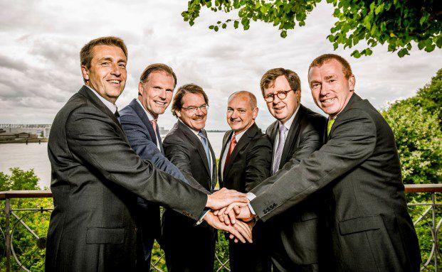 Arbeiten künftig zusammen: Vertreter von Grossmann und Berger sowie vom Bankhaus Ellwanger und Geiger.