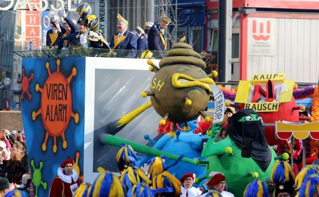 Motivwagen auf dem Rosenmontagsumzug in Köln: Zwischen Terrorangst und Kaufrausch (Foto: Ralph Goldmann/dpa)