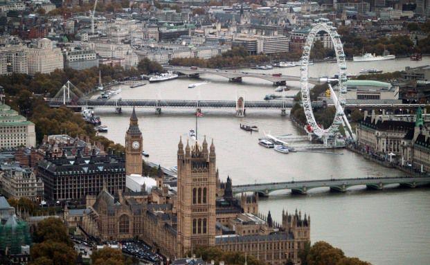 """Das Parlamentgebäude und das Riesenrad """"London Eye"""" sind <br> Wahrzeichen Londons, Foto: Getty Images"""