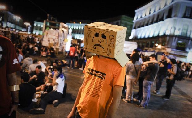 Demonstranten auf dem Platz Puerta del Sol in Madrid:<br>Ungeachtet der aktuellen Proteste sind spanische<br>Staatsanleihen ein fester Bestandteil des von Allianz GI<br> gemanagten Kapital Plus Quelle: Getty Images