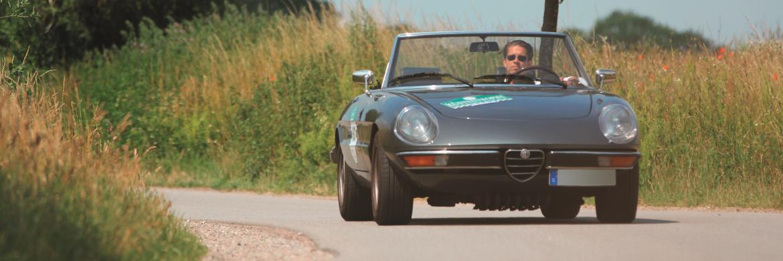 Lars Poppenheger in seinem Alfa Romeo Spider