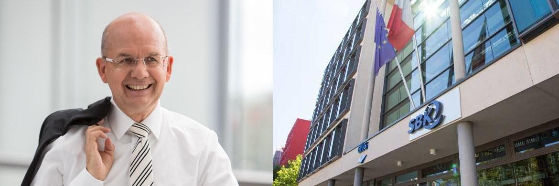 SBK-Vorstand Hans Unterhuber und Müncher Unternehmenszentrale