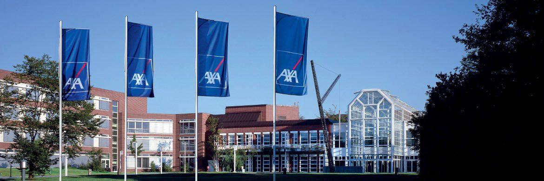 Fahnen vor der Zentrale des Versicherungskonzern Axa in Köln: Der Versicherer musste vor dem Landgericht Potsdam eine Niederlage einstecken. |© Axa