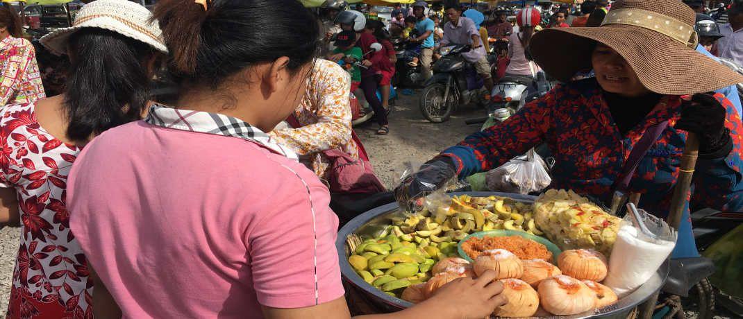Verkäuferin auf einem Markt in El Salvador: Die meisten Mikrokredite nehmen Frauen auf.|© C-Quadrat