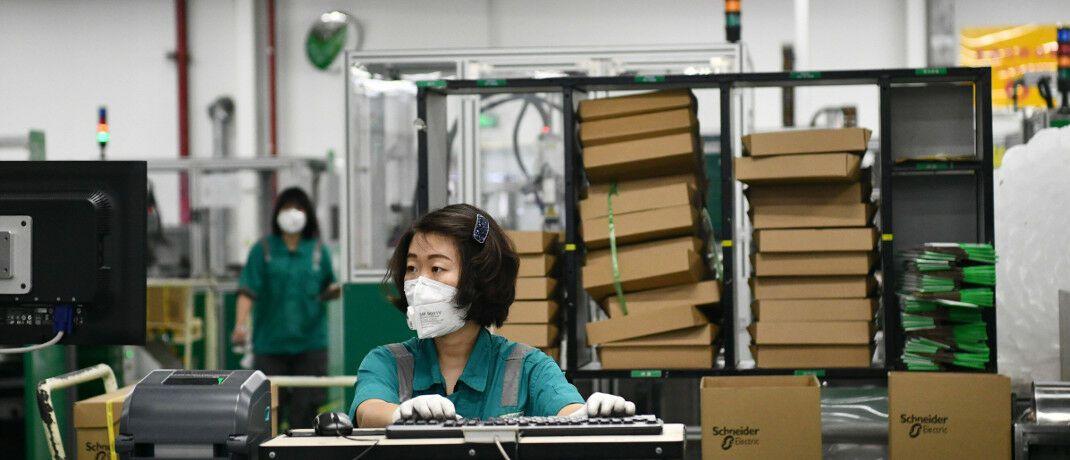 Arbeiterin in Fabrik im Norden Chinas: Die Folgen des Coronavirus für die Wirtschaft werden erheblich sein, sagt Michael Bissinger.