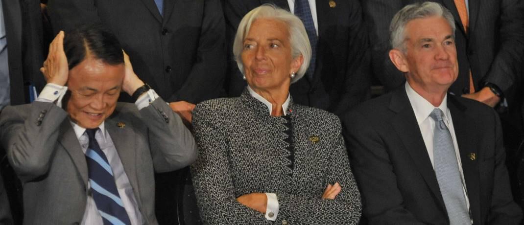 Japans Finanzminister Taro Aso, EZB-Chefin Christine Lagarde und Fed-Chef Jerome Powell (v.l.): Regierungen und Zentralbanken wollen dafür sorgen, dass kleine und mittelständische Unternehmen weiterhin Zugang zu Bankkrediten haben.|© imago images / ZUMA Press