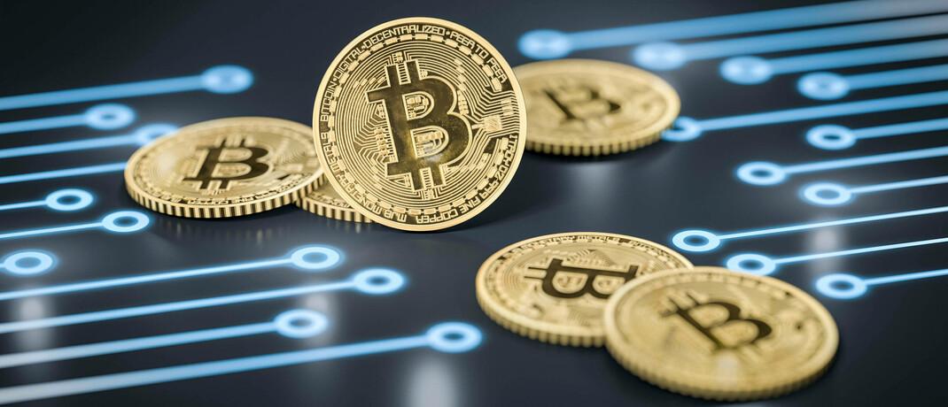 Symbolbild von Bitcoins. © Imago Images / McPHOTO