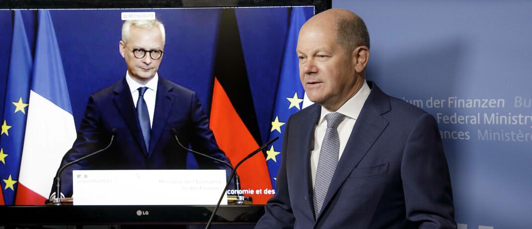 Bundesfinanzminister Olaf Scholz (r.) und sein französischer Amtskollege Bruno Le Maire geben im Vorfeld einer Ecofin-Sitzung ein Live-Statement ab.|© imago images / photothek