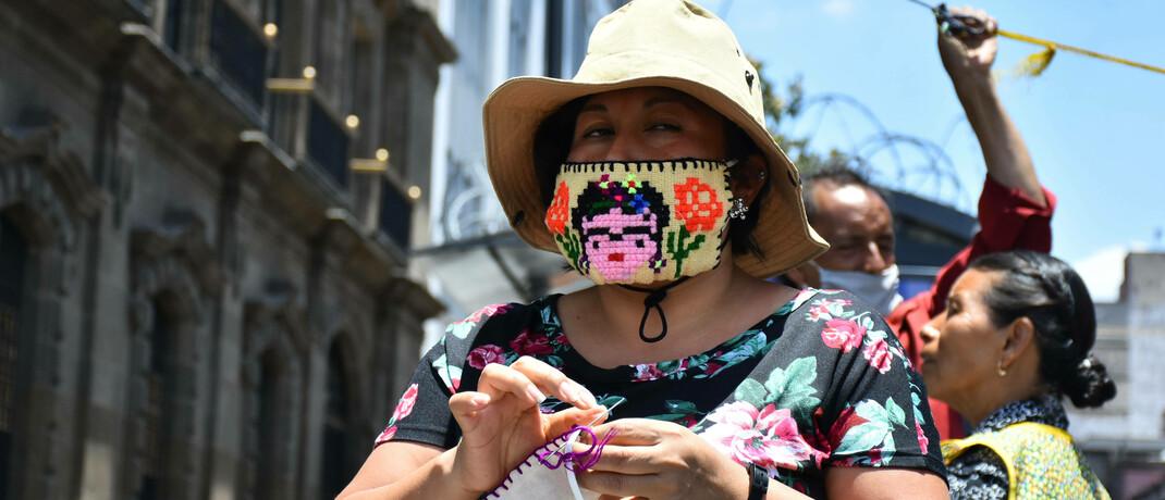 Verkäuferin von Atemschutzmasken in Mexiko-City: Die Volkswirtschaften von Argentinien, Brasilien und Mexiko erweisen sich trotz Covid-19 vergleichsweise robust.