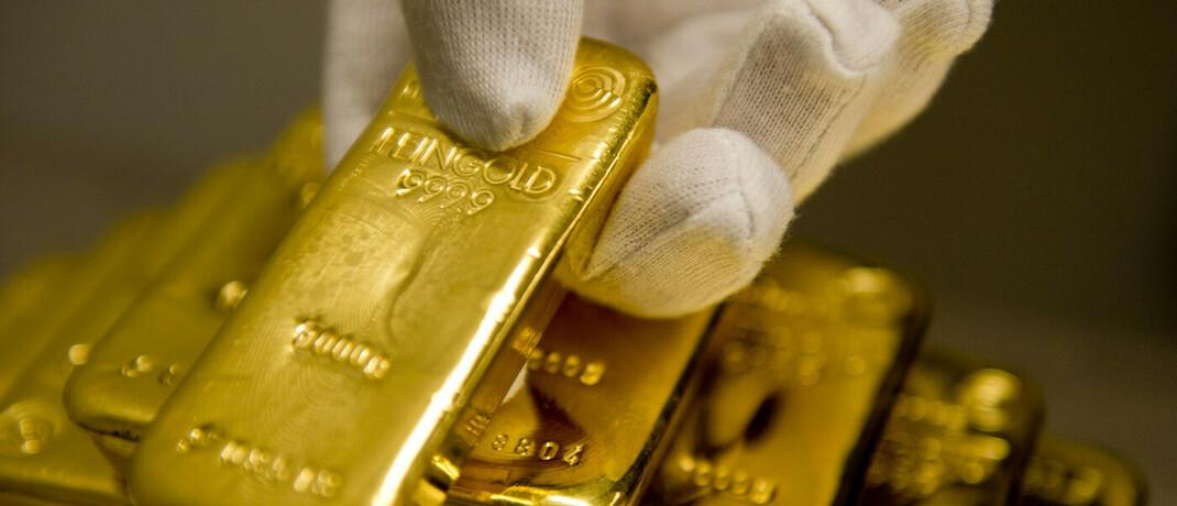 Goldbarren im Tresor eines Münchner Goldhandels: Beim Robo-Advisor Scalable Capital haben Anleger bei zwei neuen nachhaltigen ETF-Strategien die Wahl zwischen Portfolios mit oder ohne Gold-Beimischung.
