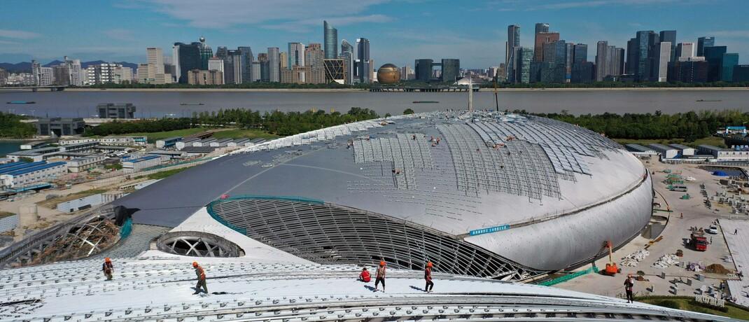 Bauarbeiten für die Asiatischen Spiele 2022 in der ostchinesischen Stadt Hangzhou: Chinas Wirtschaft wird, laut IWF, 2021 um 8,2 Prozent wachsen.