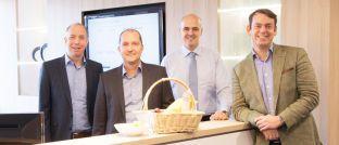 Peer Reichelt, Karsten Dümmler, Oliver Kieper und Martin Steinmeyer (von links): Der Vorstand der Netfonds AG stellt mit dem Umzug des Unternehmens in ein größeres Gebäude im Hamburger Stadtteil Hammerbrook die Weichen für weiteres Wachstum.