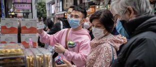 Konsumenten in Hongkong kaufen zusätzliche Atemmasken: Die geschwächte Weltwirtschaft kann dem Goldpreis weiteren Auftrieb verleihen.