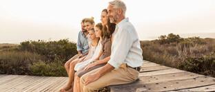 Familie in der Freizeit: Die mit nahezu sicheren Anlagen erzielbaren Renditen liegen inzwischen meist unter Null