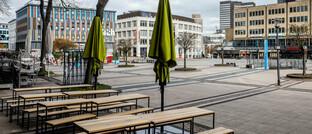 Menschenleere Innenstadt in Essen: Wann und wie die Wirtschaft schrittweise wieder hochgefahren wird, ist derzeit schwer vorherzusagen – für Anleger eine besondere Herausforderung.