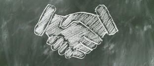 Symbolischer Handschlag