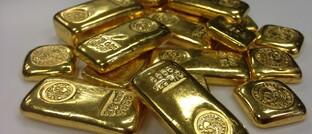 Ein Haufen Goldbarren: In Köln könnten 45 Millionen Euro von Goldanlegern verschwunden sein.