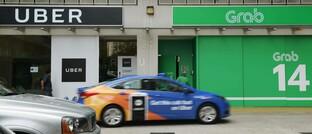 Büros des Fahrdienstes Grab und von Konkurrent Uber in Singapur